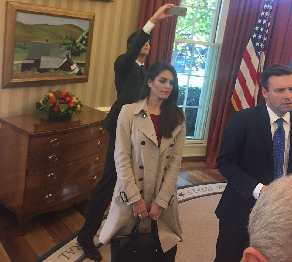 Trump's son-in-law, Jared Kushner (pictured behind Trump's campaign press secretary Hope Hicks), owner of the New York Observer and a senior adviser to the president-elect's campaign, was in the Oval Office while Trump and Obama spoke to reporters