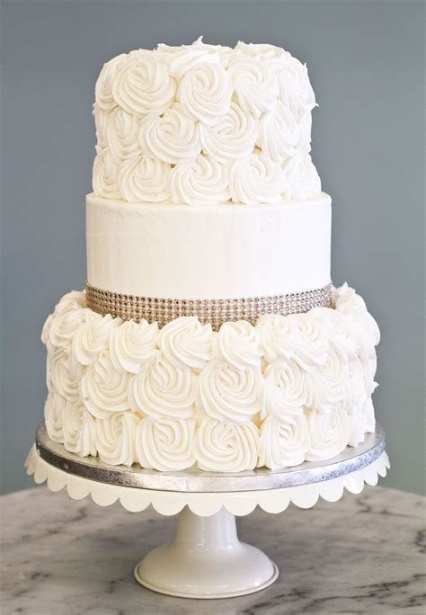 A simple, elegant wedding cake with rosettes and