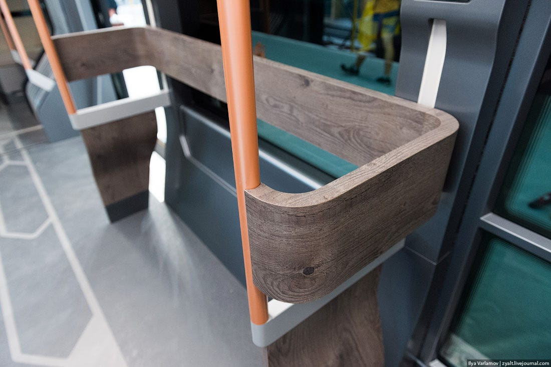 A closer look at the wooden handrails, aluminum poles, and linoleum floors.