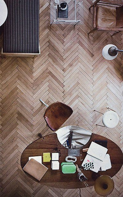 Incredible herringbone timber floors set the tone for the rest of the room with simple timber furniture and block colours.