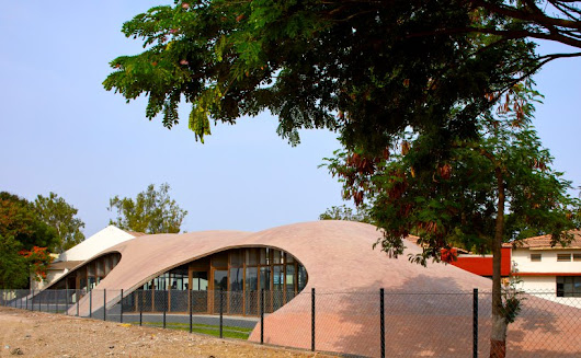 The Brick Vault Library in India by Sameep Padora & Associates features an accessible roof that rises from the landscape.
