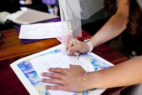 Cari signs the Ketubah