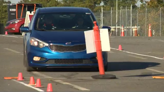 Race car driver expands defensive driving school after losing sons |