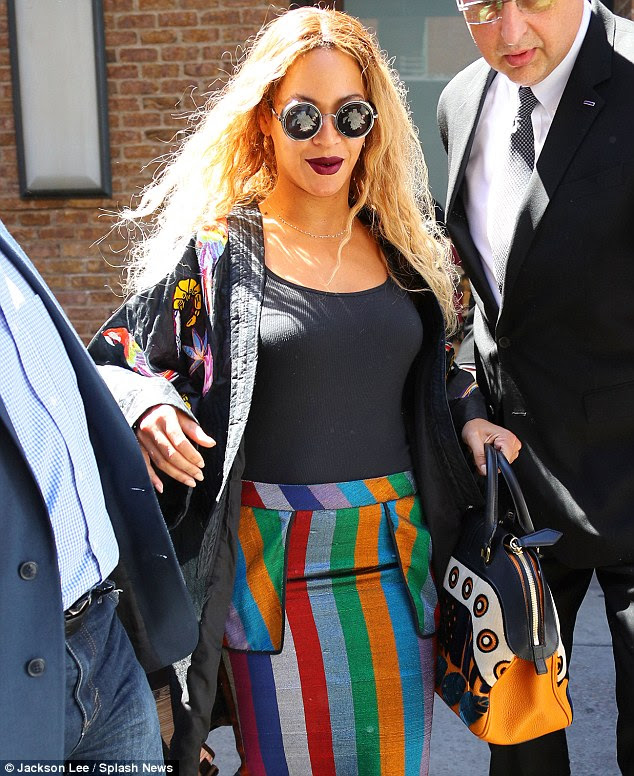 Beautiful lady: The Grammy winner topped off her summery look with a kimono; the cover up was emblazoned with brightly colored birds and flowers
