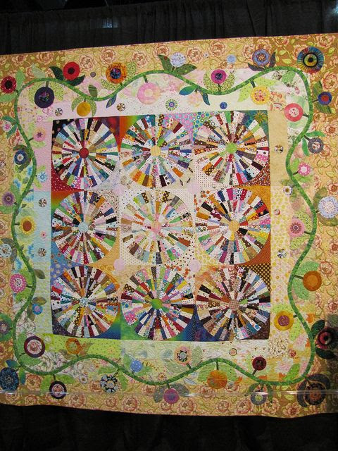 Design by Piece 'o Cake.  Quilter unknown as photo was taken At the Houston Quilt Show.