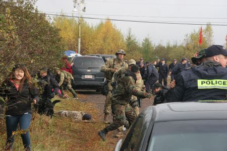 Elsipogtog youth runs in fear as RCMP descend into madness. [Photo: Miles Howe]