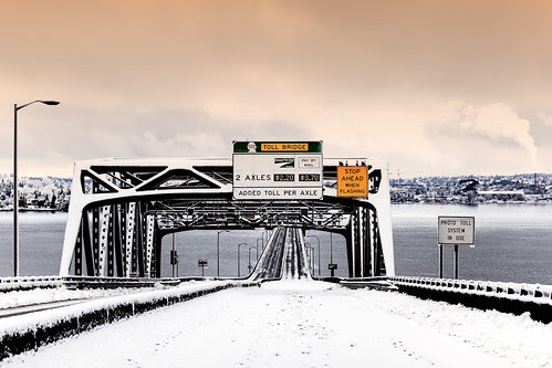 As the snow eased for the day, the setting sun turned clouds orange over the SR 520 east high rise (Explored!)