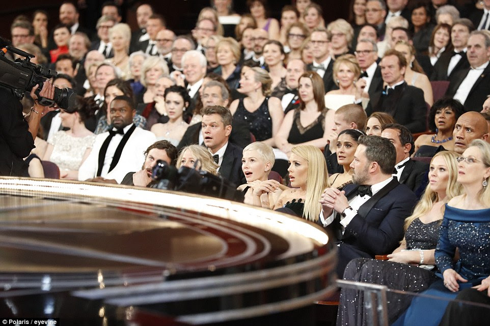 A photo has surfaced showing the stunned faces of Mel Gibson, Matt Damon, Salma Hayek, Dwayne 'The Rock' Johnson in the second row, and front row Casey Affleck, Michelle Williams, Busy Phillips, Ben Affleck and far right Meryl Streep, when the Academy Award for Best Picture was given to the wrong movie Sunday night