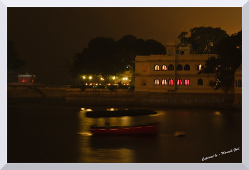 Aimless - a vacant boat drifting aimlessly on a windy night in the Lake Pichola, Udaipur