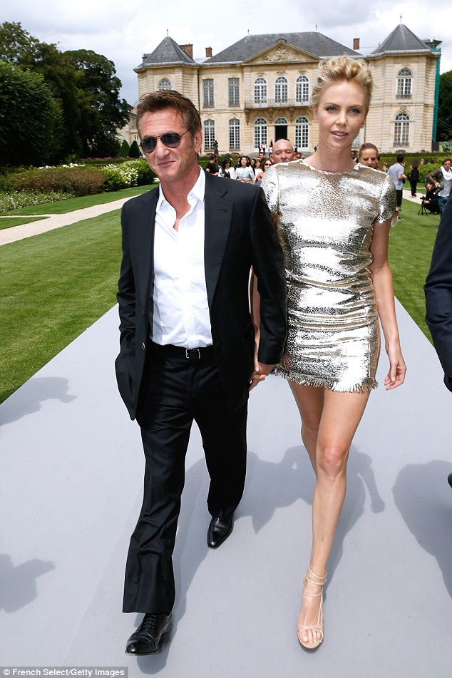 Ghosts of his past: Charlize and Sean (pictured july 2014) started dating in December 2013 after being friends for decades and reportedly they had become secretly engaged during a trip to Paris