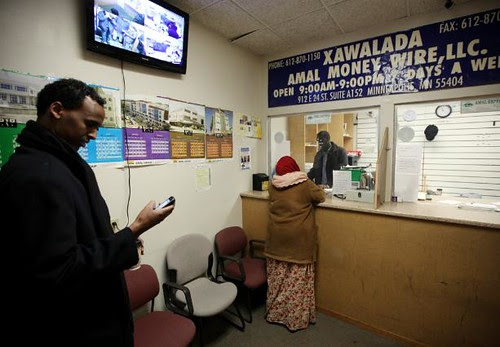Somalian-Americans line up to transfer money to their families still living inside the Horn of Africa nation. The US government has targeted Somalians for harrassment. by Pan-African News Wire File Photos