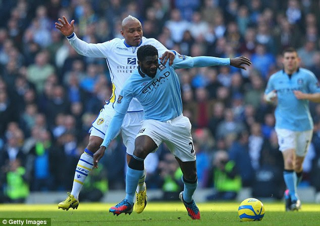 He's behind you! El-Hadji Diouf tries to rob Kolo Toure of the ball during the first-half