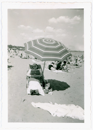 Woman and beach umbrella