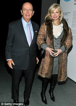 Leader: This is billionaire financier, Wilbur Ross and his wife Hilary Geary - Ross is the Grand Swipe or chief of Kappa Beta Phi, a secret society for elite Wall Street bankers
