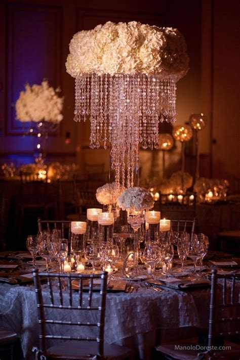 Centerpiece idea with white hydrangeas and crystal
