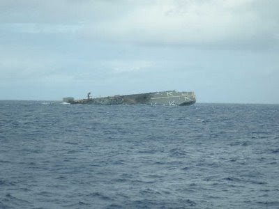 USS Belleau Wood begins to sink