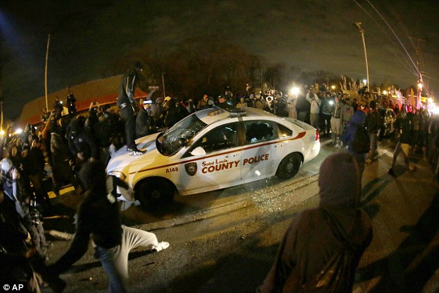 CHAOS: Peaceful vigils erupted into violence after the grand jury's decision was made public