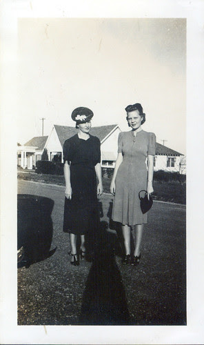 Two women in dresses with a shadow