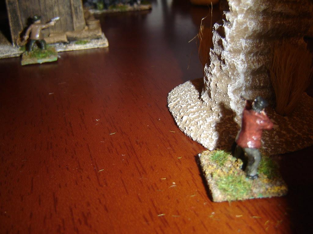 Farrell move up behind a rock column