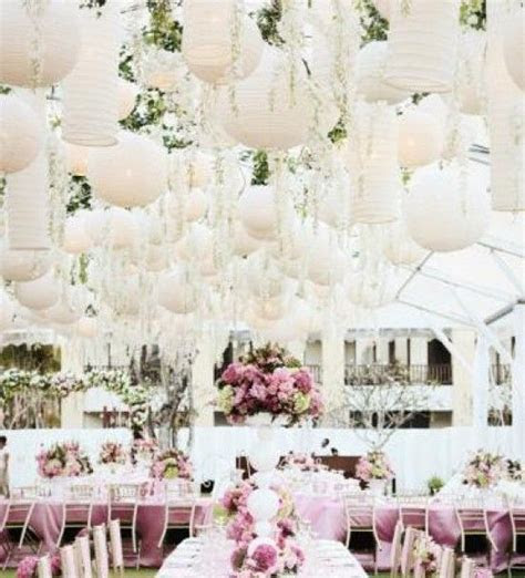 Paper lanterns and hanging flowers for wedding decor