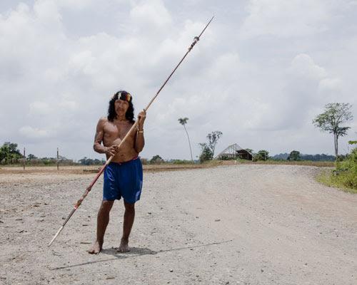 Davo Enomenga of the Waorani tribe in Yasuní, Ecuador. holding a spear.