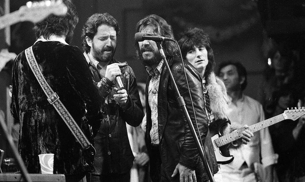 The Last Waltz concert at Winterland November 25, 1976, was filmed by Martin Scorcese In this image, Eric Clapton, Paul Butterfield, Bobby Charles and Ron Wood (Bill Graham is in the background)  The Band and many guest musicians performed, including Neil Young, Bob Dylan, Van Morrison Eric Clapton Ron Wood, Ringo Starr, Dr. John  and Joni Mitchell Photo: Gary Fong, The Chronicle
