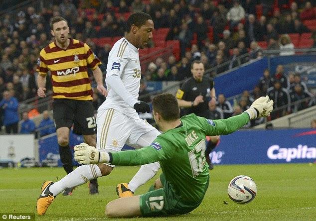 Penalty: Bradford City's goalkeeper Matt Duke brought down Swansea Jonathan de Guzman