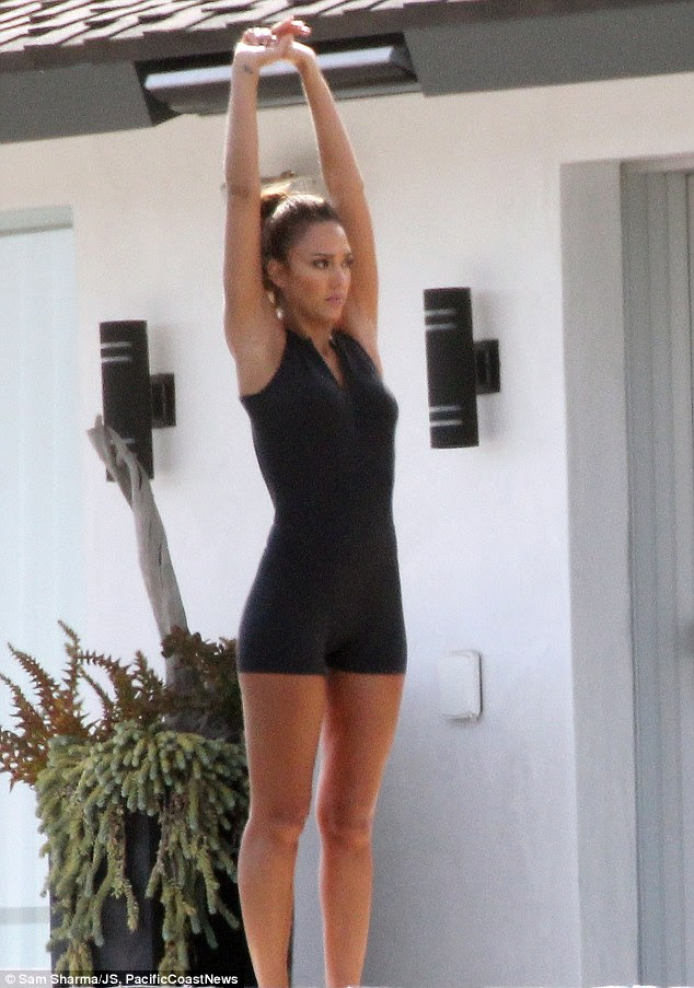 Jessica Alba steps out after stripping down to skimpy