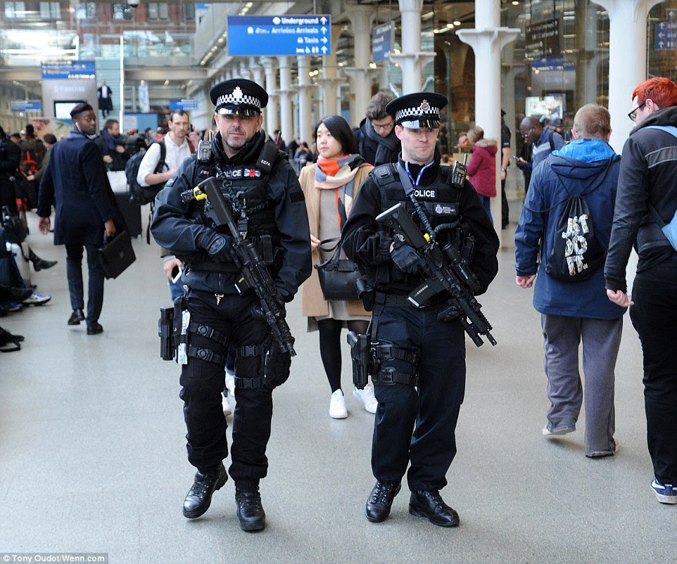 Armed officers make their way through the Eurostar terminal at St Pancras station in London. There was an increased security presence at transport hubs across the city