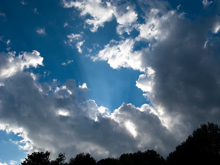 bright light leaping behind clouds