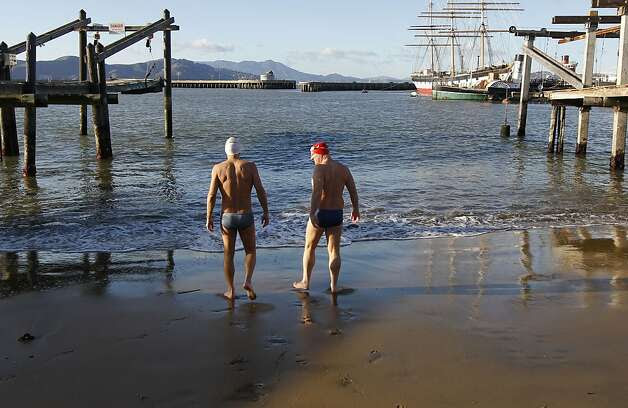 Steve Schatz (left) and Dr. Thomas Nuckton prepare for an afternoon swim off San Francisco's Aquatic Park last week. Both men are members of the Dolphin Club, which encourages swimming without wet suits. Photo: Michael Macor, The Chronicle