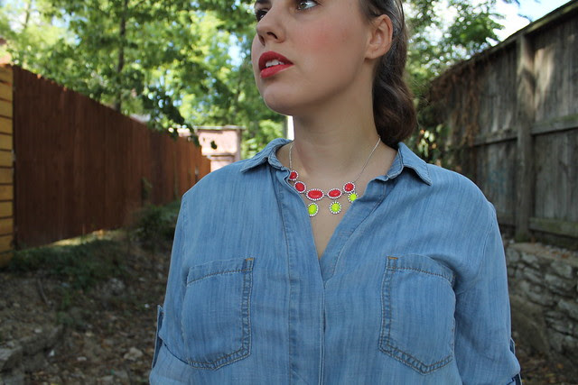 "Pop of neon outfit: gray AG ""stevie"" jeans, snakeskin shoes, chambray shirt, DIY neon necklace, neon bangle, J.Crew pavé cable bracelet, sparkly suede clutch"