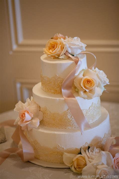 Ivory and champagne buttercream wedding cake with fondant