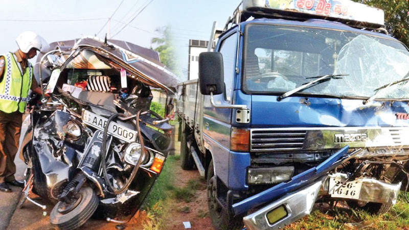 The three wheeler and lorry involved in the collision. Pictures by Sigiriya Special Corr.