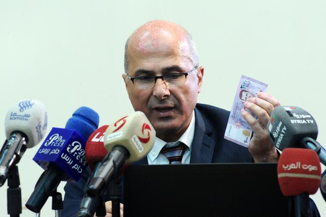 באשאר אסאד שטעלט זיין געזיכט אויף דער נאציאנאלער וואלוטע