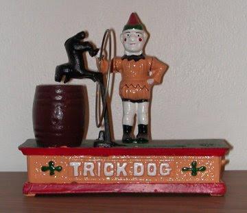 trick dog cast iron bank