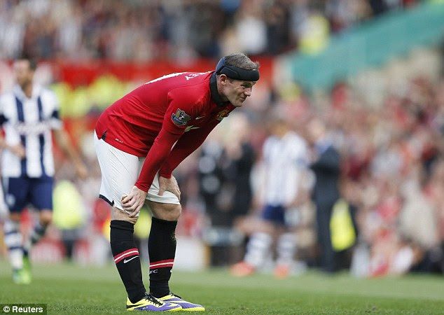 Can't believe it: Rooney looks on with shock as United drop out of the top ten in the Premier League