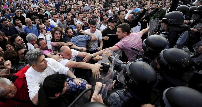 Protesters fight with police in front of a Macedonian government building in Skopje, Macedonia, May 5, 2015