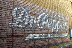 dr. pepper ghost sign in palestine