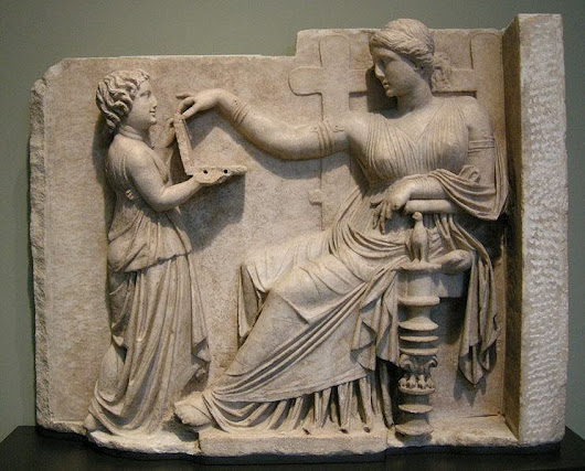 Greek statue from 110 BCE of a girl showing her mom a laptop computer