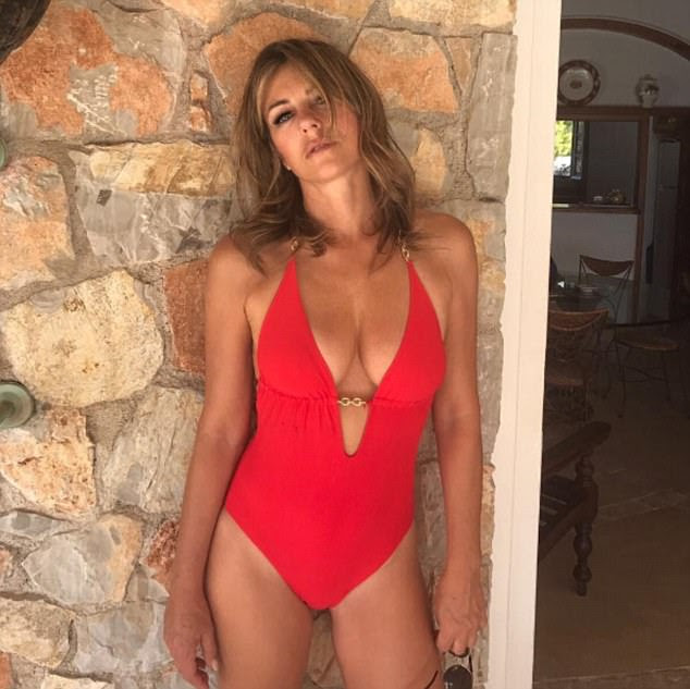 Lady in red!As a swimwear designer with a stunning body - she's her own best advertisement