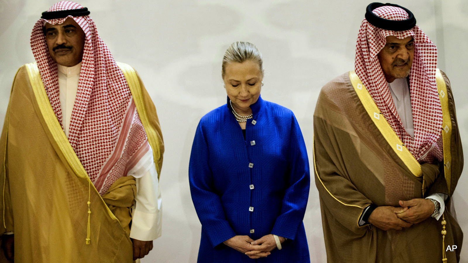 Saudi Foreign Minister Prince Saud Al-Faisal, right, U.S. Secretary of State Hillary Clinton, center, and Kuwaiti Foreign Minister Sheikh Sabah Khaled al-Hamad Al-Sabah, left, stand together prior to a group photo