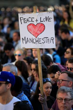 People attend a vigil for the victims of an attack on concert goers at Manchester Arena, in central Manchester, Britain May 23, 2017. REUTERS/Jon Super