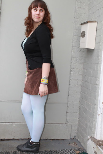 Ice blue outfit: tights, vintage suede mini skirt, dangling spike ring, virgin Mary cuff, silver and turquoise cuff