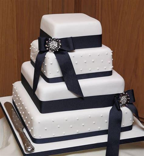 Rectangular 4 tier wedding cake with black ribbons