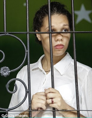 Heather Mack of Chicago in the US waits in a cell before her first hearing today