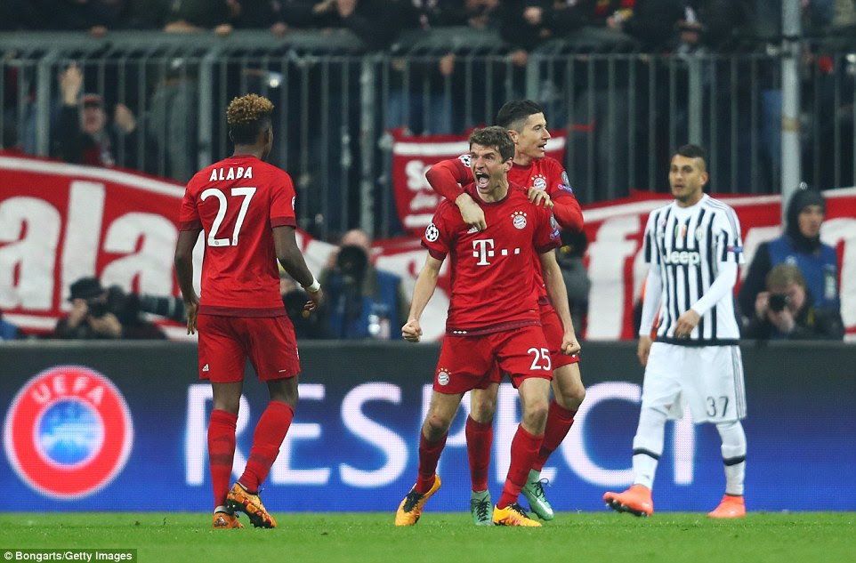Muller is congratulated by Lewandowski and roars in the direction of David Alaba after netting to save Bayern's European campaign