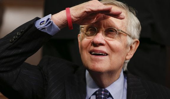 Senate Minority Leader Harry Reid of Nevada looks up into the balcony before President Barack Obama delivers the State of the Union address to a joint session of Congress on Capitol Hill in Washington, Tuesday, Jan. 12, 2016. (AP Photo/Evan Vucci)