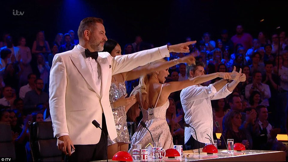 Winner! The four judges stood up as they congratulated Tokio on his win as they pointed their arms towards him