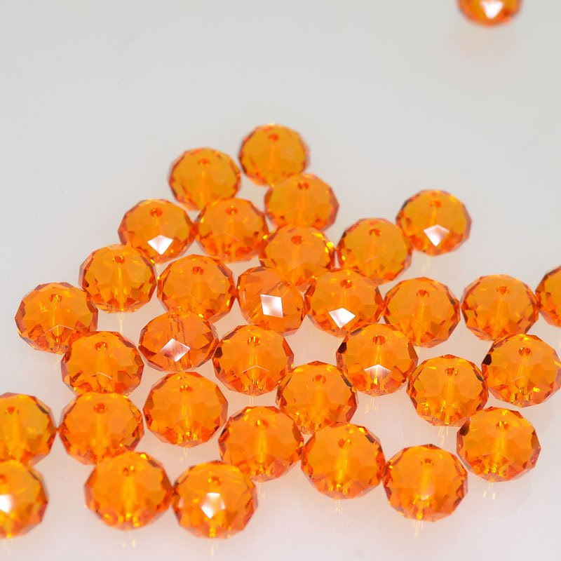 27750401029259 Swarovski Bead - 8 mm Faceted Donut (5040) - Tangerine (1)